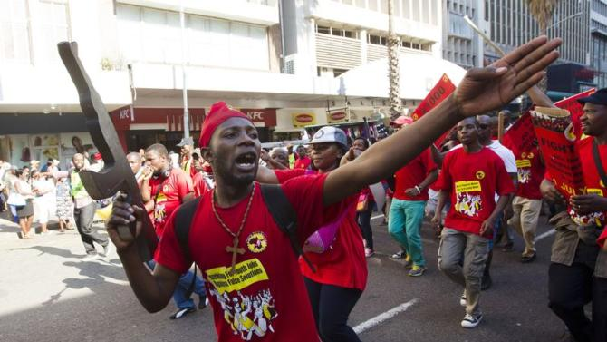 Members of the National Union of Metal Workers of South Africa (NUMSA) protest on the streets of Durban