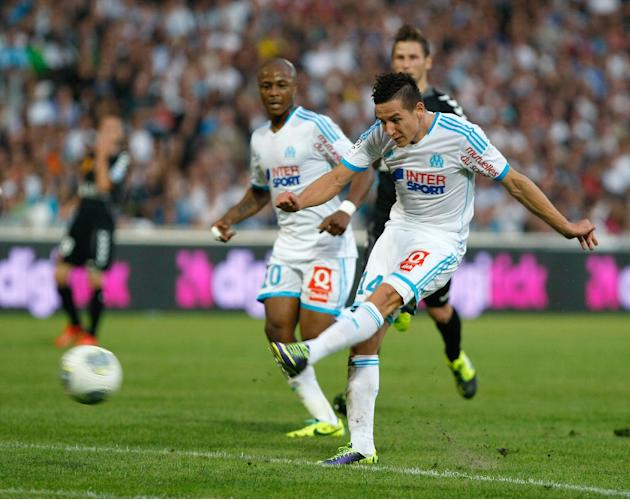 Marseille's midfielder Florian Thauvin scores against Stade de Reims, during their League One soccer match, at the Velodrome Stadium, in Marseille, southern France, Saturday, Oct. 26, 2013
