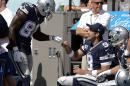 Dallas Cowboys quarterback Tony Romo (9) and wide receiver Dez Bryant (88) celebrate on the sideline after they connected on a 3-yard touchdown pass against the Tennessee Titans in the third quarter of an NFL football game Sunday, Sept. 14, 2014, in Nashville, Tenn. (AP Photo/Mark Zaleski)