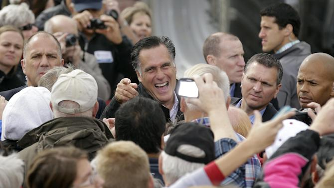 Republican presidential candidate, former Massachusetts Gov. Mitt Romney greets supporters after speaking at a campaign stop at the Koch Family Farm, Tuesday, Oct. 9, 2012, in Van Meter, Iowa. (AP Photo/Charlie Neibergall)