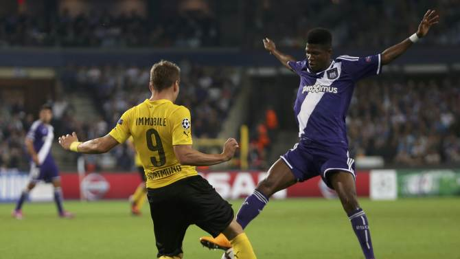 Borussia Dortmund's Immobile kicks the ball in front of Anderlecht's Conte during their Champions League soccer match in Brussels