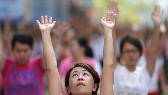 A participant exercises during Mega Yoga Day in Kuala Lumpur