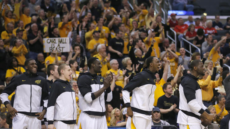 Wichita State players smile and applaud as their team scored against La Salle during the first half of a West Regional semifinal in the NCAA men's college basketball tournament, Thursday, March 28, 2013, in Los Angeles. (AP Photo/Jae C. Hong)