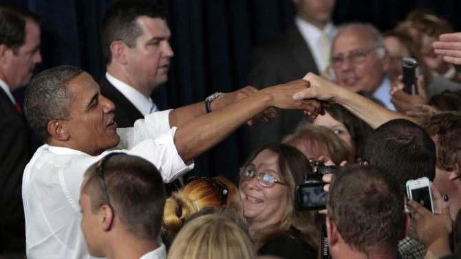President Barack Obama speaks to a crowd of supporters during his stop at the Truckee Meadows Community College in Reno, Nev., Tuesday, Aug. 21, 2012. (AP Photo/Rich Pedroncelli)