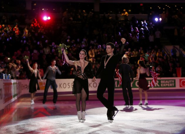 Virtue and Moir of Canada wave to the crowd after the ice dance free dance at the ISU World Figure Skating Championships in London, Ontario