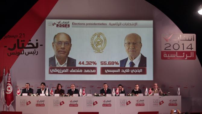 Members of the Independent Election Commission hold a news conference in Tunis