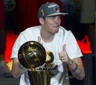 Miami Heat's Mike Miller celebrates with the NBA Championship trophy during a public celebration for the team Monday, June 25, 2012 in Miami. (AP Photo/J Pat Carter)