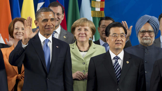 FILE - In this June 18, 2012 file photo, Chinese President Hu Jintao, right, and U.S. President Barack Obama, left, take their places with other leaders for the Family Photo during the G20 Summit in Los Cabos, Mexico. As Hu steps down as head of China's Communist Party after 10 years in power, he's hearing something unusual for a Chinese leader: sharp criticism. (AP Photo/Carolyn Kaster, File)