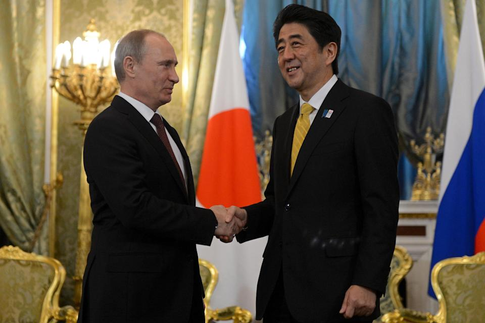 Russian President Vladimir Putin shakes hands with visiting Japanese Prime Minister Shinzo Abe, right, during a meeting in Moscow's Kremlin on Monday, April 29, 2013. Abe is in Russia on an official visit. (AP Photo/Kirill Kudryavtsev, Pool)
