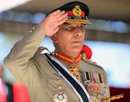 Pakistan Army Chief General Ashfaq Parvez Kayani salutes a guard of honour during a ceremony in Diyatalawa, on June 29, 2013