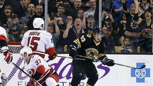 Marchand scores 2 in Bruins' 6-2 win over Carolina
