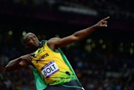 Jamaica&#39;s Usain Bolt celebrates after winning the men&#39;s 100m final at the athletics event during the London 2012 Olympic Games in London