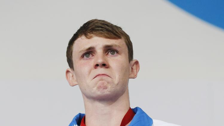 Scotland's Murdoch cries after receiving his gold medal for the men's 200m breaststroke at the 2014 Commonwealth Games in Glasgow, Scotland