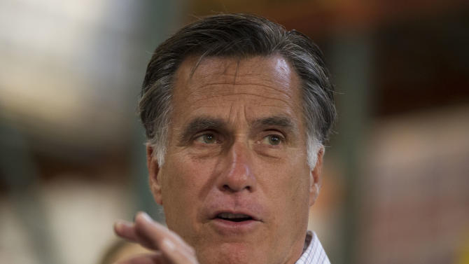 Republican presidential candidate, former Massachusetts Gov. Mitt Romney gestures during remarks to volunteers working at the Care and Share Food Bank of Southern Colorado to distribute food to those affected by the wild fire at the on Tuesday, July 10, 2012 in Colorado Springs, Colo. (AP Photo/Evan Vucci)