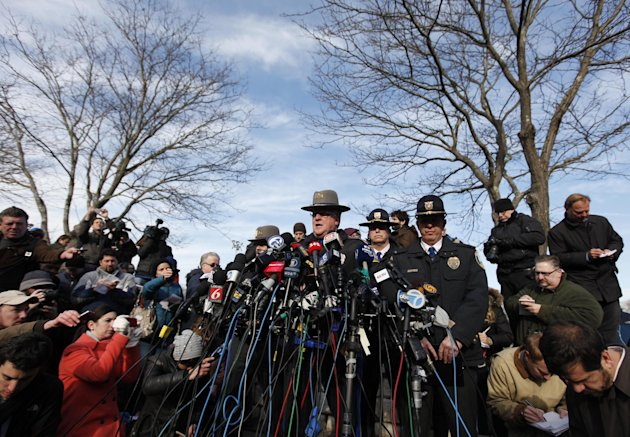 Lt. J. Paul Vance of the Connecticut State Police conducts a news briefing, Saturday, Dec. 15, 2012 in Newtown, Conn. The massacre of 26 children and adults at Sandy Hook Elementary school elicited horror and soul-searching around the world even as it raised more basic questions about why the gunman, 20-year-old Adam Lanza, would have been driven to such a crime and how he chose his victims. (AP Photo/Jason DeCrow)