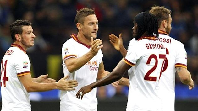 Francesco Totti of Roma celebrates scoring against Inter (Reuters)
