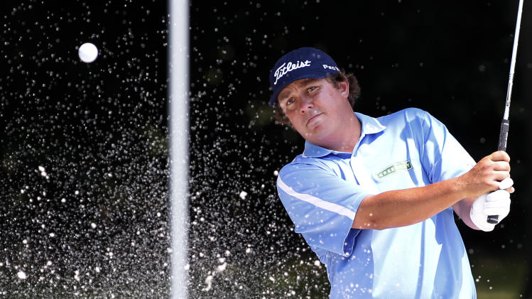 Jason Dufner hits out of a bunker onto the eighth green during the second round of the PGA Colonial golf tournament Friday, May 25, 2012, in Fort Worth, Texas.  (AP Photo/Tony Gutierrez)
