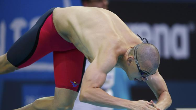 Cseh of Hungary starts in the men's 100m butterfly semi-final at the European Swimming Championships in Berlin