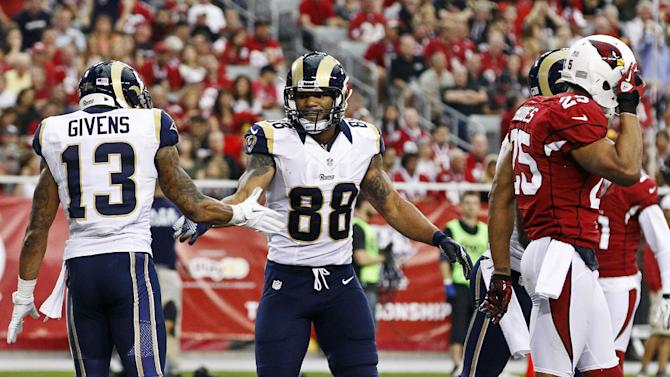 St. Louis Rams' Lance Kendricks (88) celebrates his touchdown with Chris Givens (13) as Arizona Cardinals' Kerry Rhodes (25) walks away during the first half in an NFL football game, Sunday, Nov. 25, 2012, in Glendale, Ariz. (AP Photo/Ross D. Franklin)