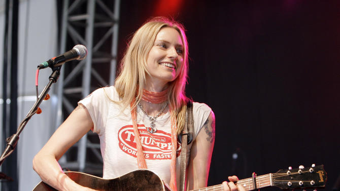 "FILE - This June 15, 2008 file photo shows Aimee Mann at the Bonnaroo music festival in Manchester, Tenn. Mann has a new song born of her experience riding out this week's superstorm in a Brooklyn hotel. Called ""Sandy"" and sung to the tune of Barry Manilow's ""Mandy,"" the humorous song cheered a storm-weary concert audience in New York's Westchester County Thursday, Nov. 1, 2012. (AP Photo/Mark Humphrey, file)"