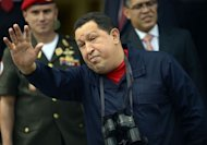 Venezuelan president Hugo Chavez gestures during the visit of Belarusian Deputy Prime Minister Vladimir Semashko at Miraflores presidential palace in Caracas on June 2. In a crowded square of the biggest shantytown in Caracas, Chavez&#39;s reelection campaign wheels are spinning. But a bit like a movie missing its star, the president is not on the trail