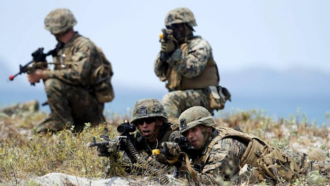 """U.S. military forces take positions during annual """"Balikatan"""" (shoulder-to-shoulder) war games with Filipino soldiers at the shore of San Antonio"""