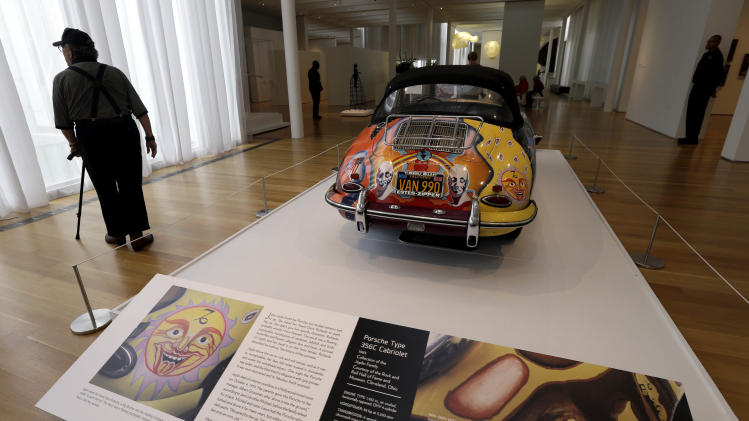 In this photo taken Wednesday, Oct. 9, 2013 a 1965 Porsche Type 356 C Cabriolet that once belonged to Janis Joplin is seen as part of the Porsche By Design Seducing Speed exhibit at the North Carolina Museum of Art in Raleigh, N.C. (AP Photo/Gerry Broome)