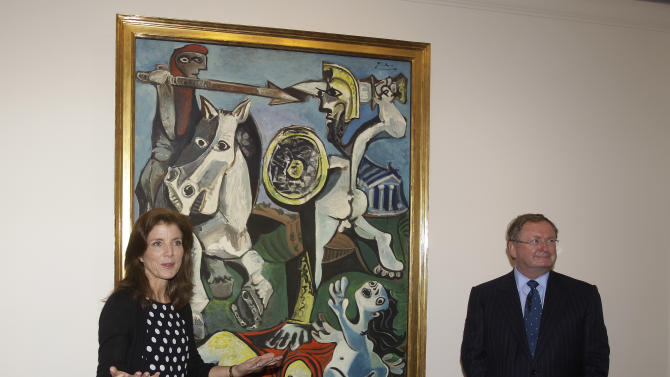 "Caroline Kennedy, president of the John F. Kennedy Library Foundation, and Malcolm Rogers ,of the Museum of Fine Arts in Boston, unveil Pablo Picasso's painting ""Rape of the Sabine Women"" at the JFK Library and Museum in Boston, Thursday, Oct. 4, 2012. The painting is on loan to the library from the MFA in commemoration of the upcoming 50th anniversary of the Cuban Missile Crisis, which was Picasso's inspiration for the work. (AP Photo/Stephan Savoia)"