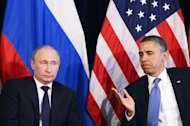 "US President Barack Obama (R) gives the floor to Russian President Vladimir Putin to speak after a bilateral meeting in Los Cabos, Mexico on June 18, 2012 on the sidelines of the G20 summit. Obama and Putin have called for an ""immediate"" end to the Syria conflict"