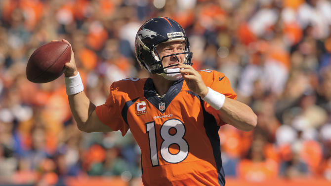 Denver Broncos quarterback Peyton Manning (18) passes the ball against the Philadelphia Eagles in the first quarter of an NFL football game, Sunday, Sept. 29, 2013, in Denver. (AP Photo/Jack Dempsey)