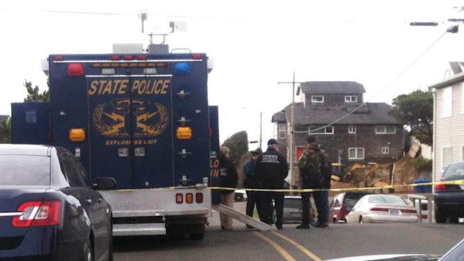 A police vehicle parks on a street near the Westshore Oceanfront Suites Tuesday, March 12, 2013, in Lincoln City, Ore., where authorities believe Michael Boysen, who is suspected of killing his grandparents last weekend in Renton, Wash., is located. (AP Photo/Lauren Gambino)