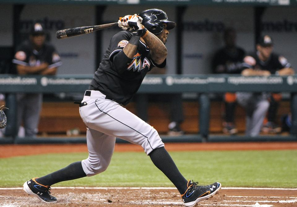 Miami Marlins' Jose Reyes follows through on his two-run single off Tampa Bay Rays pitcher James Shields during the second inning of an interleague baseball game Saturday, June 16, 2012, in St. Petersburg, Fla. (AP Photo/Brian Blanco)