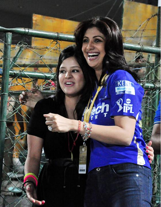 Rajasthan Royals owner Shilpa Shetty with Sakshi, wife of MS Dhoni during the match between Chennai Super Kings and Rajasthan Royals at Sawai Mansingh Stadium, Jaipur on May 12, 2013. (Photo: IANS)