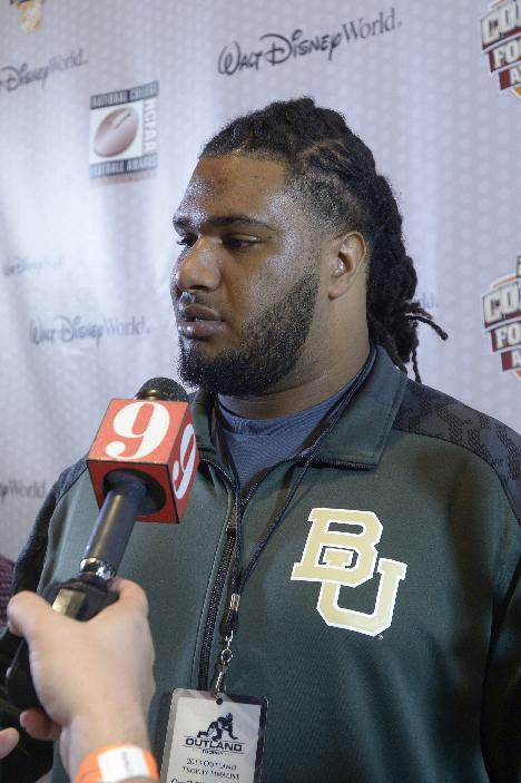 Baylor offensive lineman Cyril Richardson answers questions during a media availability prior to the College Football Awards show in Lake Buena Vista, Fla., Wednesday, Dec. 11, 2013