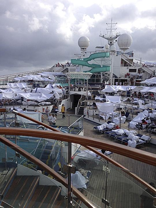 This Sunday, Feb. 10, 2013 photo, provided by Kalin Hill, of Houston, shows passengers with makeshift tents on the the deck of the Carnival Triumph cruise ship at sea in the Gulf of Mexico. The ship n