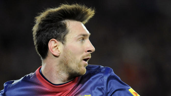 Barcelona's Lionel Messi, from Argentina, eyes the ball during his team's Spanish League soccer match against Osasuna at Camp Nou stadium in Barcelona, Spain, Sunday, Jan. 27, 2013. Barcelona won the match 5-1. (AP Photo/Alvaro Barrientos)