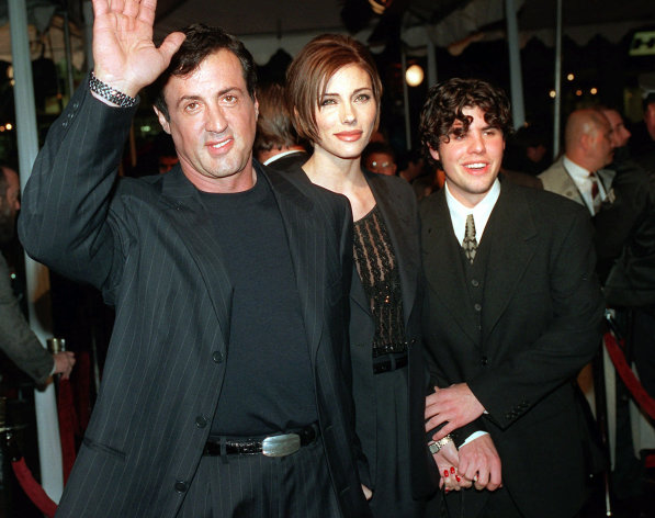 "FILE - In this Dec. 5, 1996 file photo, Sylvester Stallone, left, star of the film ""Daylight,"" arrives at the film's world premiere with his girlfriend Jennifer Flavin, center, and his son Sage Stallone, who co-stars in the film, in Hollywood district of Los Angeles. Coroner's officials determined Thursday, Aug. 30, 2012 that Sage Stallone died from a heart condition that causes blockage of the arteries and his death has been determined to be from natural causes. (AP Photo/Kevork Djansezian, File)"