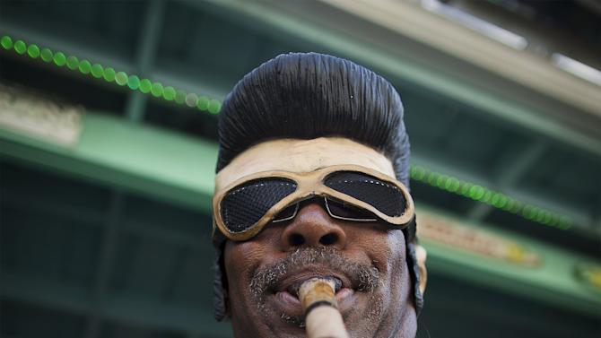 Bill Marion of Seattle, Washington wears an Elvis mask at the Beach House Bar & Grill during the 2015 Atlantic Beach Memorial Day BikeFest in Myrtle Beach