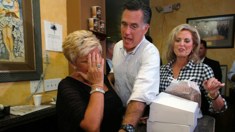 Republican presidential nominee Romney insists on paying for pastries and soup during a visit to La Tersesita Restaurant in Tampa