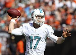 Miami Dolphins quarterback Ryan Tannehill throws a pass during the fourth quarter of their NFL football game against the Cleveland Browns