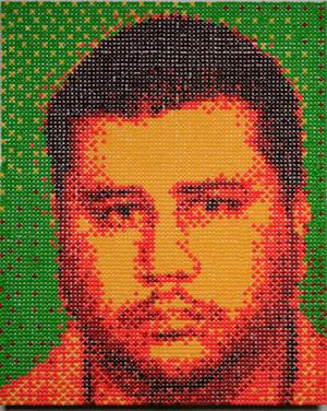This photo provided by RedLine Gallery shows a portrait of George Zimmerman. A Denver artist has created a portrait of Florida shooting suspect George Zimmerman using more than 12,000 Skittles _ the candy that 17-year-old Trayvon Martin was carrying when Zimmerman fatally shot him. The 3-by-4-foot portrait was done by 31-year-old Andy Bell, an art student about to graduate from Metro State College in Denver.  (AP Photo/RedLine Gallery, Andre Daughtry) MANDATORY CREDIT
