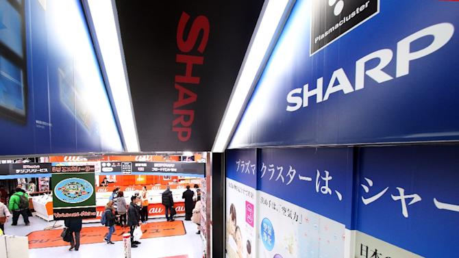 Shares in Sharp tumbled nearly 10 percent in early trade after the Nikkei business daily reported that the struggling electronics maker plans to request aid