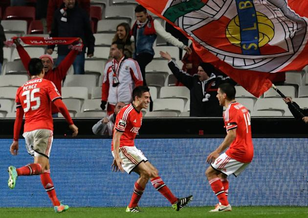Benfica's Nico Gaitan, from Argentina, center, celebrates after scoring the opening goal during their Portuguese league soccer match with Sporting Tuesday, Feb. 11, 2014, at Benfica's Luz stad