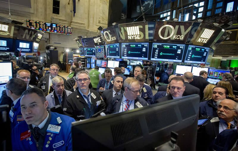 Wall St. inches up in wake of February rally