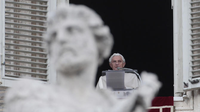 Pope Benedict XVI reads his message during the Regina Coeli prayer from his studio's window overlooking St. Peter's square at the Vatican, Sunday, April 15, 2012. (AP Photo/Gregorio Borgia)
