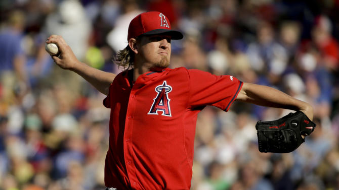 Los Angeles Angels starting pitcher Jered Weaver throws against the Chicago Cubs during the first inning of a spring training baseball exhibition game in Mesa, Ariz., on Thursday, March 26, 2015. (AP Photo/Chris Carlson)