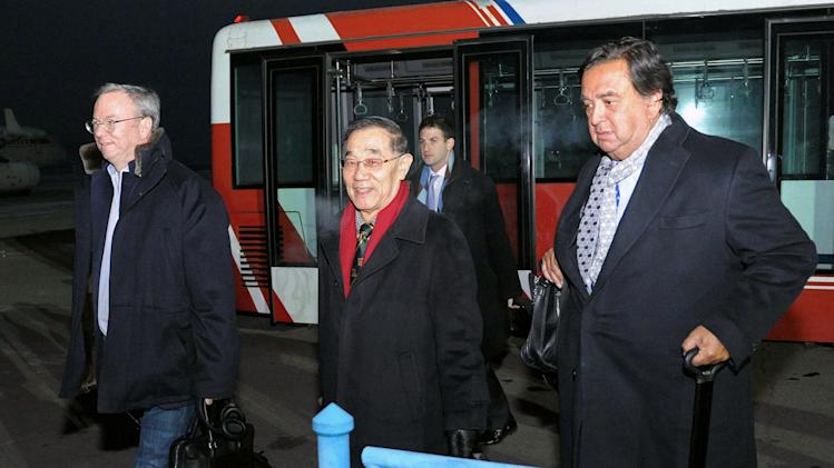 Eric Schmidt, executive chairman of Google, left, and former New Mexico Gov. Bill Richardson, right, arrive at an airport in Pyongyang, North Korea, Monday, Jan. 7, 2013.  The Google chairman wants a first-hand look at North Korea's economy and social media in his private visit Monday to the communist nation, his delegation said, despite misgivings in Washington over the timing of the trip.  (AP Photo/Kyodo News) JAPAN OUT, MANDATORY CREDIT, NO LICENSING IN CHINA, HONG KONG, JAPAN, SOUTH KOREA AND FRANCE