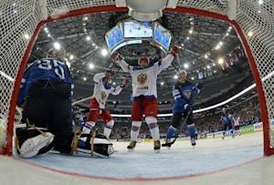 Russia's Yakovlev celebrates a goal against Finland as goalie Rinne reacts during their men's ice hockey World Championship final game at Minsk Arena in Minsk