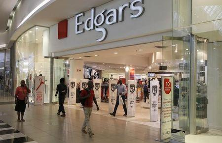Shoppers walk past an Edgars store at a shopping centre in Soweto, southwest of Johannesburg
