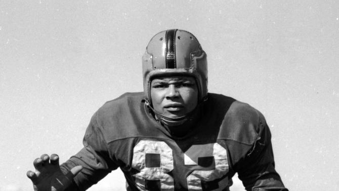 FILE - In this Aug. 31, 1955, file photo, Notre Dame football player Wayne Edmonds poses for a photo in South Bend, Ind. (AP Photo/File)
